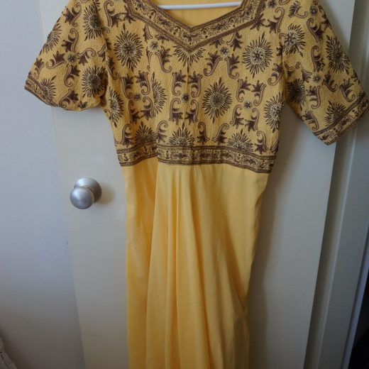 yellow salwar top with brown embroidery