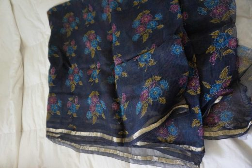 body of navy blue sari with flowers