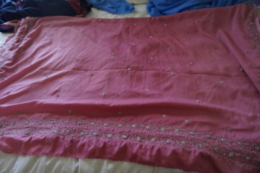 pink sari with silver sequins
