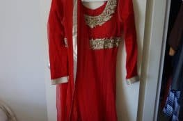 red anarkali with gold work