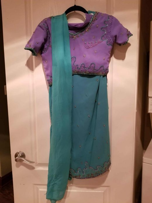 front of purple and turquoise lehenga set