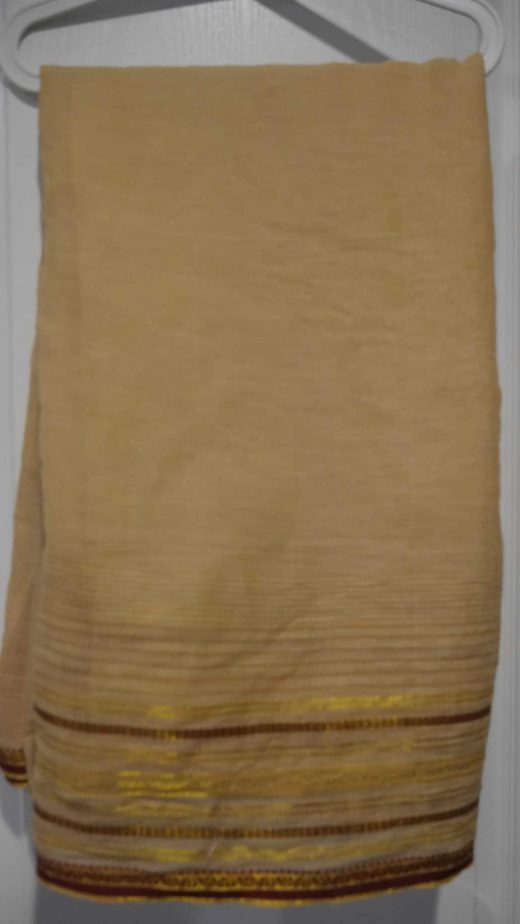 beige sari with red and gold border