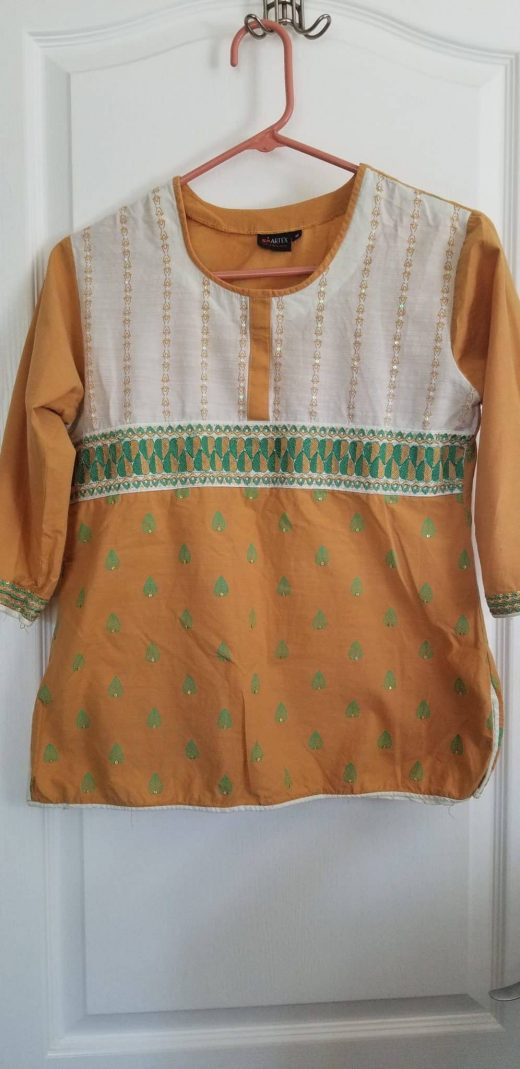 front of yellow and green tunic