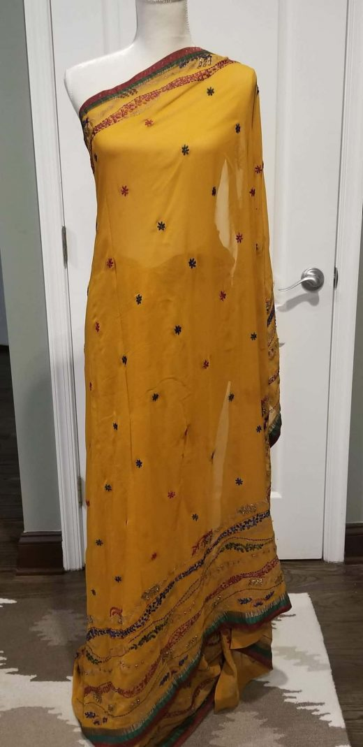 front of yellow saree with red, blue and green border
