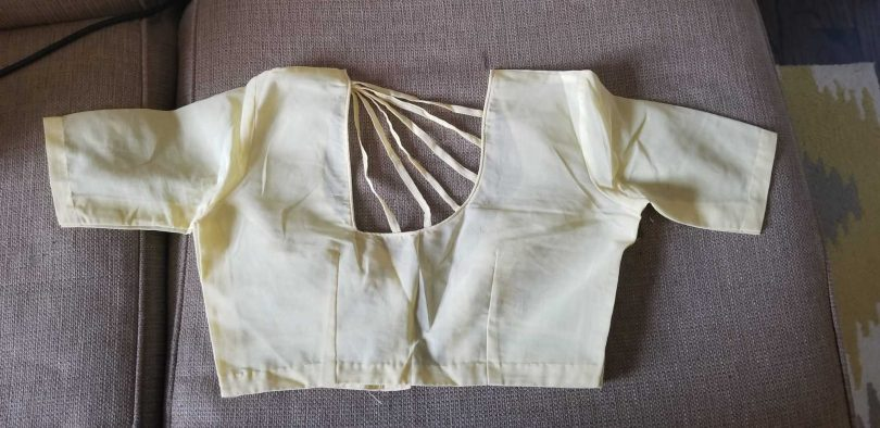 back of beige blouse
