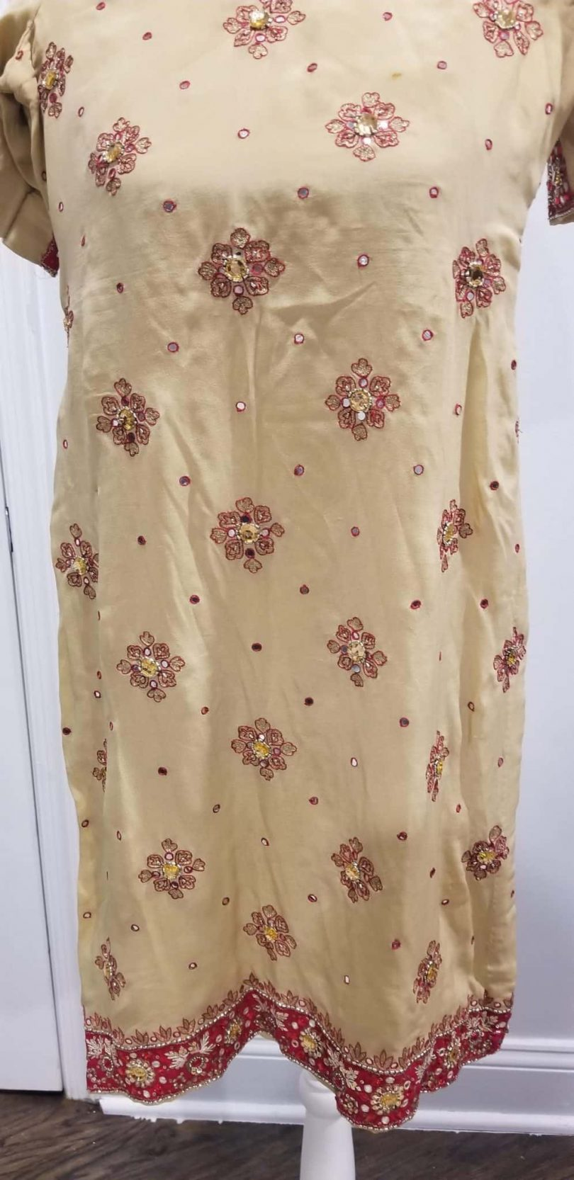 front of beige and red salwar