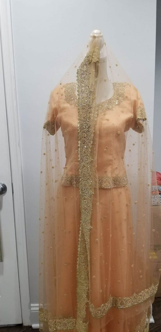 peach and gold lehenga with shawl