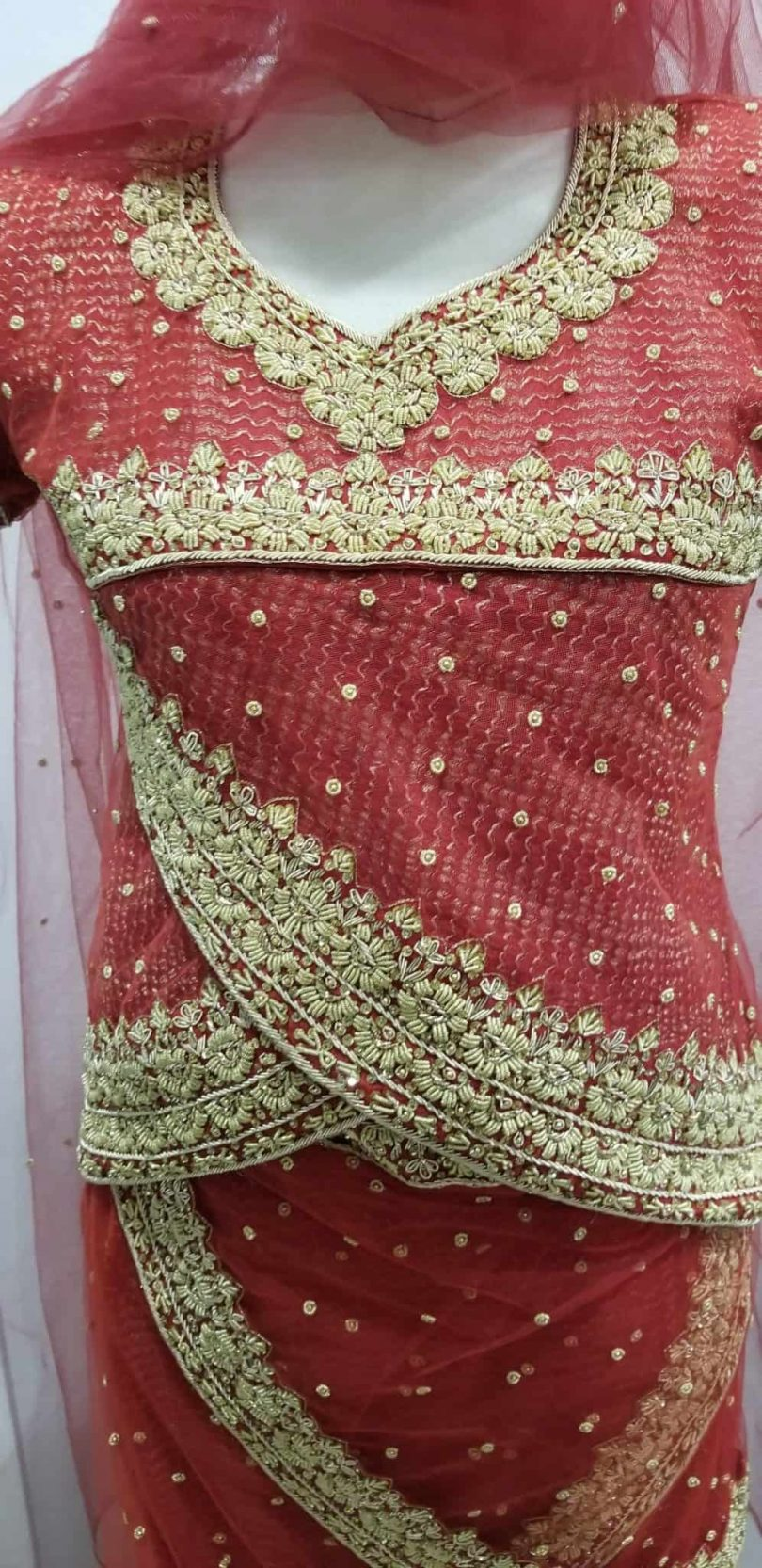 top of pinkish red lehenga
