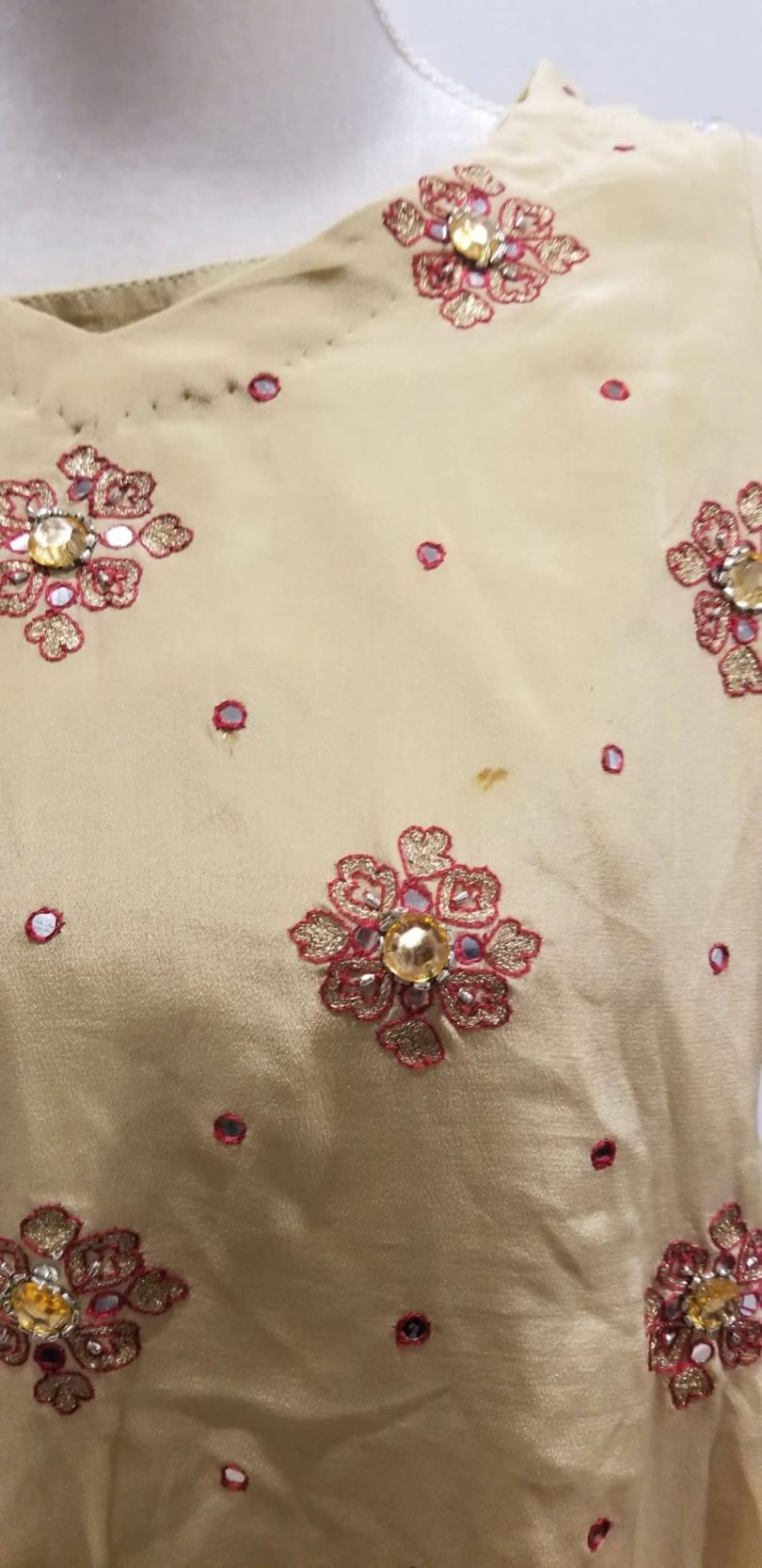 minor stain on front of red and beige salwar