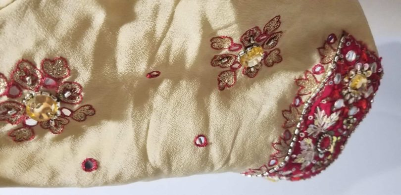 sleeve of beige and red salwar