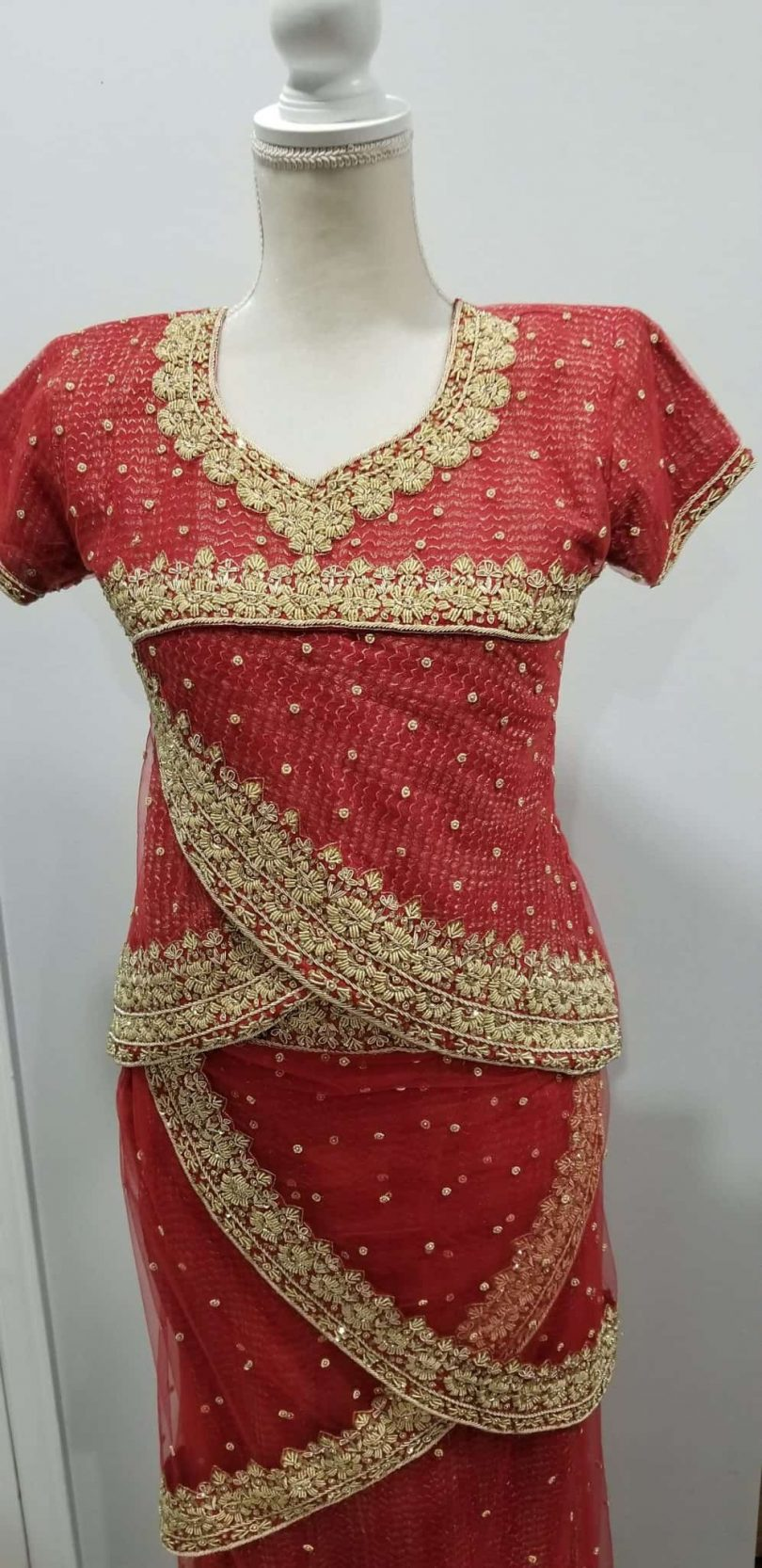 top half of pinkish red lehenga