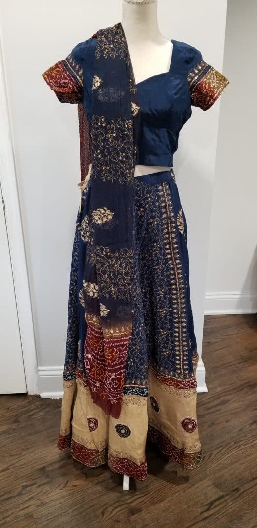 front of blue gujarati style lehenga red and beige