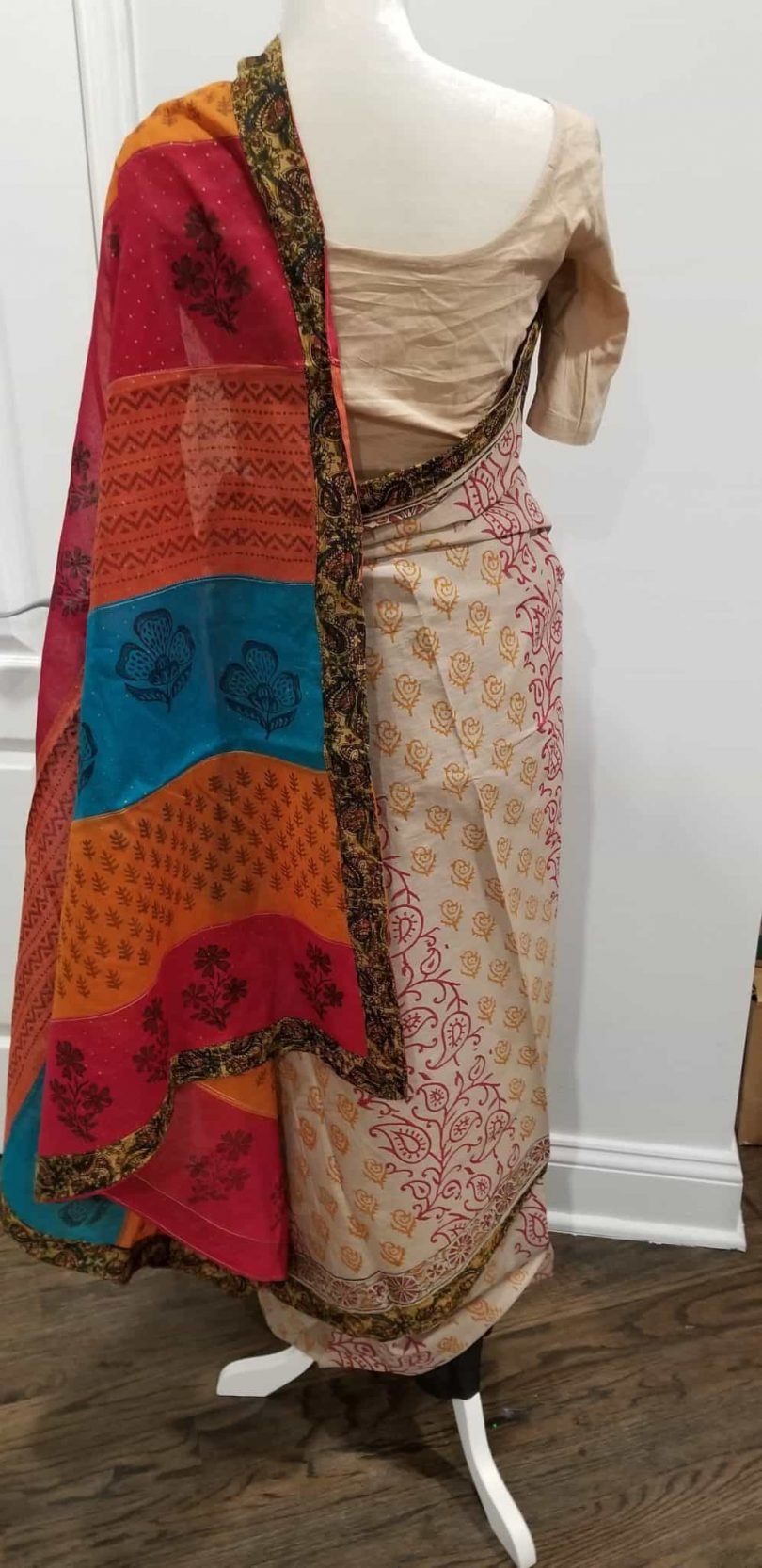 back 2 of beige saree with multicolored palu