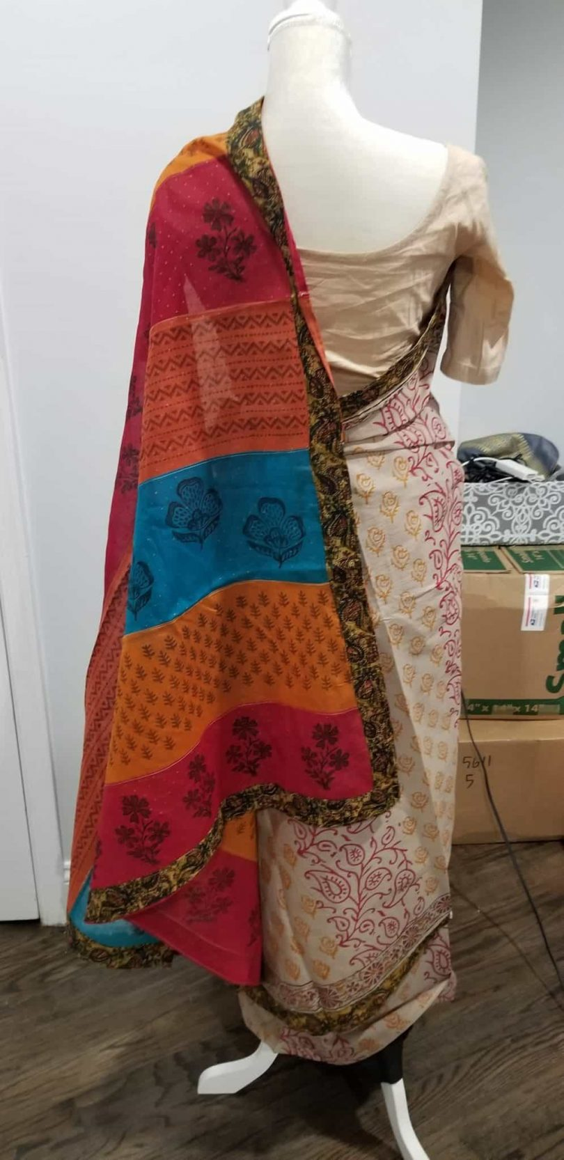 back of beige saree multicolored palu