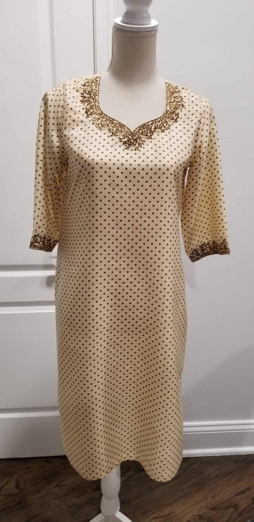 front of beige tunic with polk-a-dot