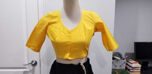 front of bright yellow blouse