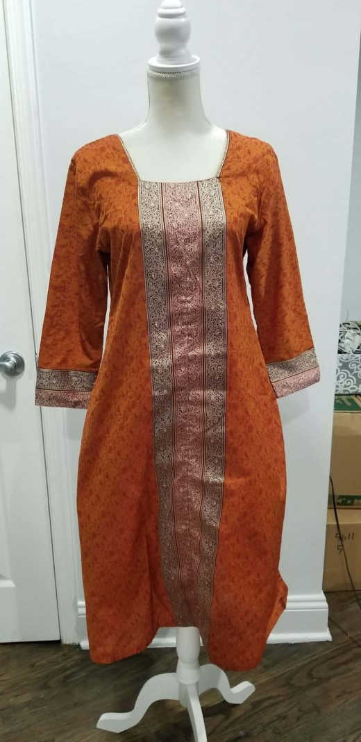 orange salwar top with red and gold stripes