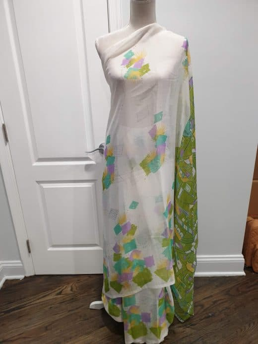 white sari with green, blue, yellow, and purple abstract pattern