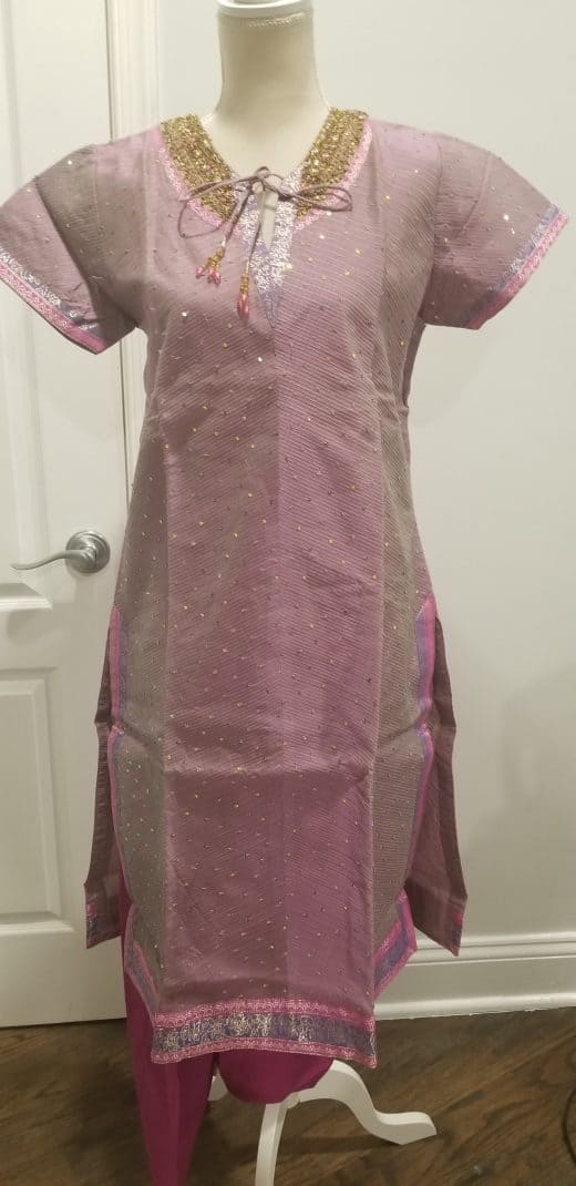 front of pink, purple, and gold salwar
