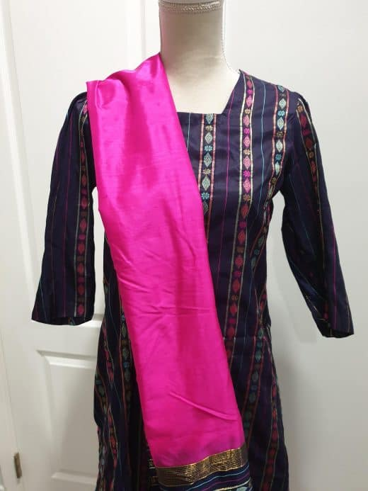 front of pink and blue salwar with pink, blue, and white weave stitch