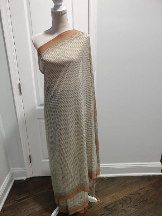 white saree with grey flowers and beige border